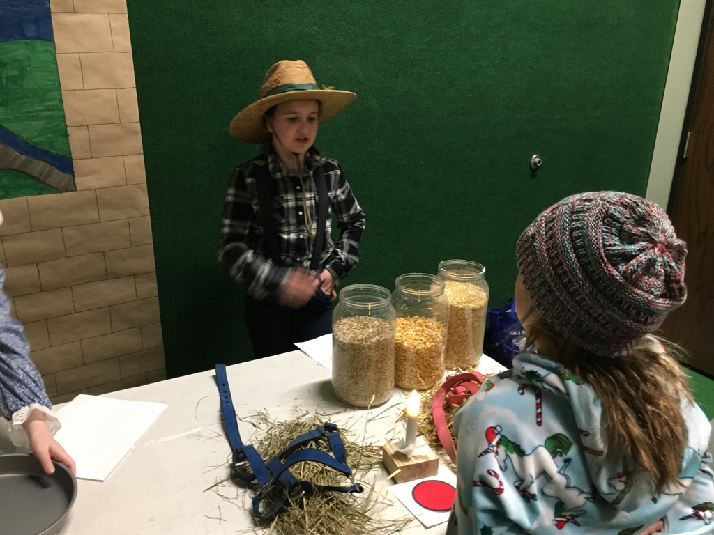 Kristen performs a colonial farmer.